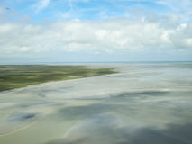 Sea tide landscape. Landscape of the sea coast after tide with cloudy sky in Britain Stock Photo