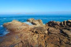 Sea tide waves on rocks Stock Photo