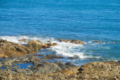 Sea tide waves on rocks Royalty Free Stock Image