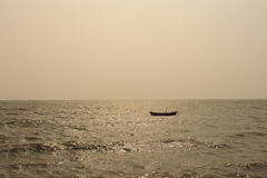 Sea in time evening and fishing trawler Royalty Free Stock Images