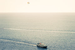 Sea and touristic yacht with paraglider Landscape Stock Images