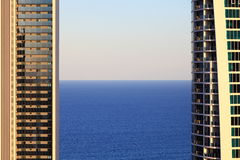 Sea between modern apartment towers by twilight Royalty Free Stock Photo