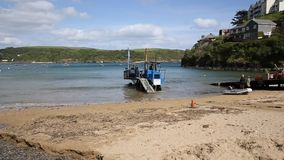 Sea tractor enters the water South Sands beach Salcombe Devon south west England UK stock video footage