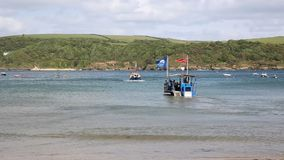 Sea tractor meets ferry South Sands beach Salcombe Devon south west England UK stock footage