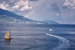 Sea traffic under the rainbow Stock Photos