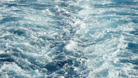 Sea Trail From the Stern of a Cruise Boat. View of the waves from the deck of a cruise stock video footage