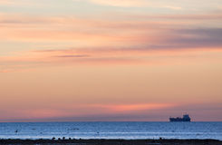 Sea transport in sunset Royalty Free Stock Photography