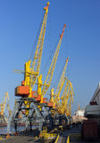 Sea transportations. Cranes in sea port for cargo industry Stock Images