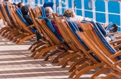 Sea Travel Cruise Ship Relax. Sea Travel and Cruise Ship Relax. People Relaxing on Deckchairs During Transatlantic Cruise Royalty Free Stock Images