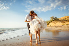 Sea travel, happy couple hugging on  side near hot summer water of ocean. Honeymoon picture with copy space Stock Photography