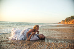 Sea travel, happy couple hugging on  side near hot summer water of ocean. Honeymoon picture with copy space Stock Image