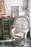 Sea travel styled shabby chic  interior corner with map wicker ch Royalty Free Stock Image