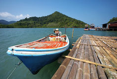 Sea travel in thailand. Red boat and blue sea in thailand Stock Photo