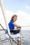 Sea Travelling Concepts: Sensual Caucasian Woman Sailing on Yach Stock Photos