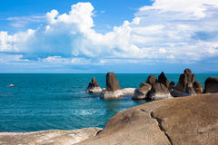 Sea on tropical island with stones Stock Photography