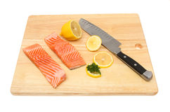 Sea trout fillets on a board Stock Photography
