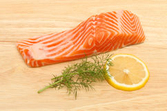 Sea trout and lemon Stock Image