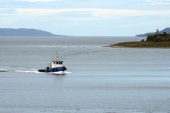 The sea tug at the Beagle channel shore estates Harberton. Stock Images