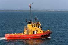 Sea tugboat under power in harbour. Royalty Free Stock Photos