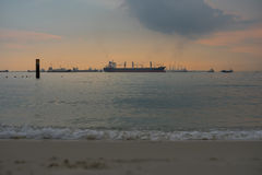 Sea in twilight it so quiet have cargo ship and dock background, Royalty Free Stock Photo