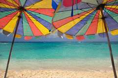 Sea and umbrella. The twin umbrella with beautiful beach and clear sky royalty free stock photos