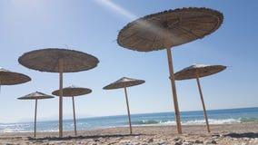 Sea umbrellas shadows autum in Preveza stock photography