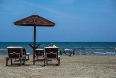Sea umbrellas with table on beach stock photo