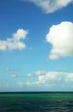 Sea under a cloudy sky Stock Photos