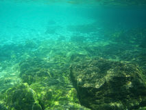 Sea underwater. Background with sunrays in the sea underwater stock photography