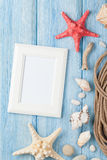 Sea vacation with blank photo frame, star fish and marine rope Stock Images