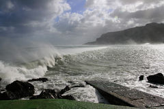 Sea vawes crashing on wind. Weather. storm and winds on mediterranean sea. View of Pellegrino's mount Stock Photography