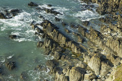 Sea on vertical rock strata Stock Image
