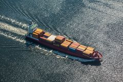 A sea vessel is a container ship at full speed in the open sea. View from above.n royalty free stock image