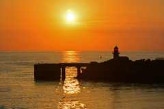 Sea view. Sea when undergoing the evening sun with lighthouse stock images