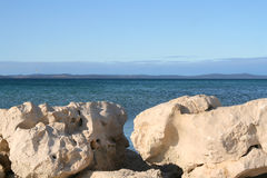 Sea view. View of the adriatic sea with white stones Stock Photos