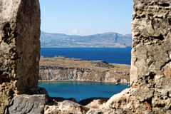 Sea view. Through the stones. Greece royalty free stock image
