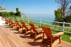 Sea view area with wooden chairs Royalty Free Stock Images