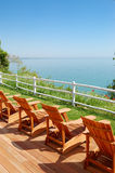 Sea view area with wooden chairs Stock Photography