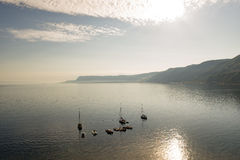 Sea view in backlight with moored boats Royalty Free Stock Photos