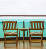 Sea view from balcony with chairs and table royalty free stock image