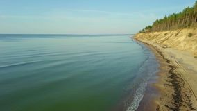 Sea view with beach and steep bank. In autumn day stock video footage