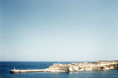 Sea view with beacon in the Maltese coast. Horizontal Royalty Free Stock Photography