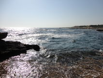 Sea View. The beautiful Mediterranean sea, glistening in the sunlight & lapping over rocks Royalty Free Stock Images
