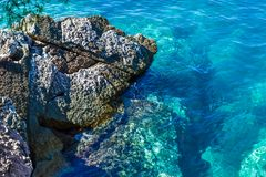 The sea view. Beautiful view from the mountain to the calm Adriatic sea. Blue clear water and large stones. Royalty Free Stock Photo