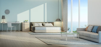 Sea view bedroom and living room in luxury beach house. 3d rendering of interior with bed, table and sofa Royalty Free Stock Image