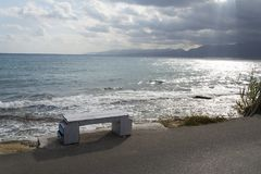 Sea view from the bench. Sea view from the bench on the coast of the island of Crete Royalty Free Stock Photo