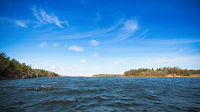 Sea view with blue sky and small waves Royalty Free Stock Photos
