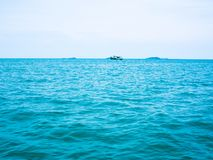 Sea view with boat, getaway holiday vacation background concept.  Stock Image