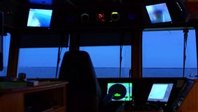 Sea view from bridge of ship rocking. Evening after sunset stock video footage
