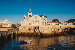Sea view of Cascais city in Portugal at sunrise with fishing boa. Ts visible. Cascais, Lisbon District, Portugal Royalty Free Stock Image